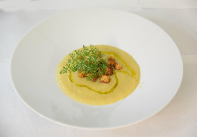 Soup with seasonal herbs and a drizzle of extra-virgin Querceta olive oil