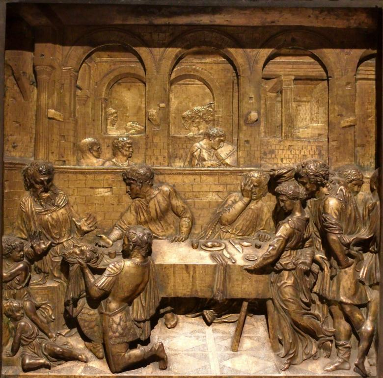 Herod's Banquet by Donatello on the Baptismal font in the San Giovanni Baptistery, Siena